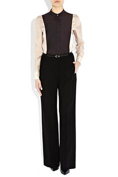 A modern, glamorous take on the high-waisted trend that is proving very popular this season. Classic black wool straight leg design, with detachable belt. Pair with another seasonal must-have, the Bastyan shirt with their girlish charm and quality tailoring.