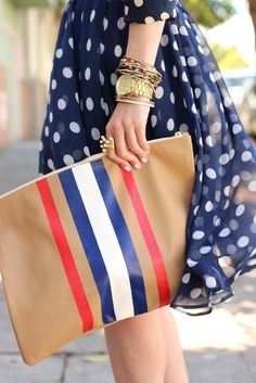 Navy with white polka dots, tricolore striped camel leather clutch