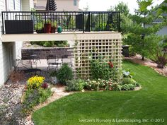 Minnesota Landscaping : Outdoor living space and enjoyment were greatly enhanced with the addition of a paver patio that extended under the existing deck.  Utilizing the space under the deck is extremely comforting on warm days because of the shade it provides.  The retaining wall and steps help define the space and create a wonderful entrance into this wonderful garden room... enjoy!  Anchor Paving Stones - Multi-Color Blend Borgert Step Units - Slate Shore Color Blend Keystone Country…