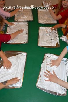 dollar store cookie sheet & shaving cream! LOVE THIS instead of the whole table would make clean up easier!!