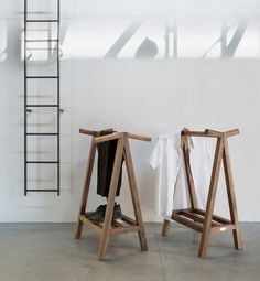 The Servant 01 valet stand from LUGI still has all the components of a traditional valet stand; while the photo above doesn't show it, there's a tray you can add between the top bar and the shoe rack, and the shoe rack can also be replaced by a tray.