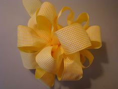 Whether it'sa bow for a gift, a wreath, a floral arrangement or your daughter's hair, this easy method of making bows willmake you an expert in no time! Many years ago, my mother taught me how to makebows and they consistently turn out so beautifully that I've had to make bows for everyone I know...
