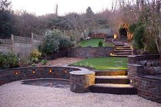 Need help with your sloping garden design? Here are 5 tips on how to turn your garden's awkward angle into an asset without massive hillside landscaping Sloped Backyard, Sloped Garden, Backyard Landscaping, Garden Ideas For Sloping Gardens, Steep Hillside Landscaping, Terraced Backyard, Landscaping Ideas, Steep Gardens, Gardens On A Slope