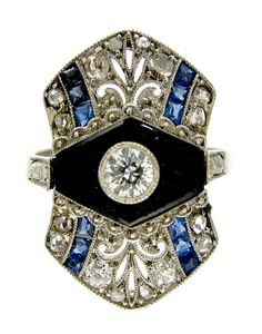 Art Deco Onyx, Sapphire & Diamond Ring Art Deco (1920-1935) A stunning Art Deco ring with all the hallmarks of the period. Good design – use of onyx and diamonds and small sapphires. Set in 18ct gold and platinum.   Date & OriginArt Deco (1920-1935), English