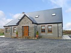 """stone facade gabled entry (steep pitch on gable to give it that """"feel"""" even though the roof is not very steep) and then the add on to the side also with stone facade. Modern Bungalow Exterior, Bungalow House Design, Cottage Design, Bungalow Designs, Old Cottage, Cottage House Plans, Cottage Homes, Irish Cottage, Dormer House"""