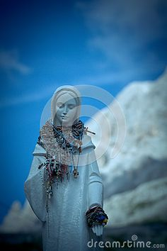 The statue of Mary on Vajolet towers, Dolomites (Alps), Italy.