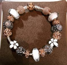 PANDORA Silver and Gold Bracelet with White Faceted Murano.......