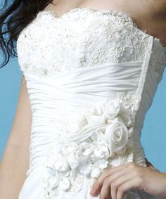 Pretty bodice embellished with lace, crystals and beading.
