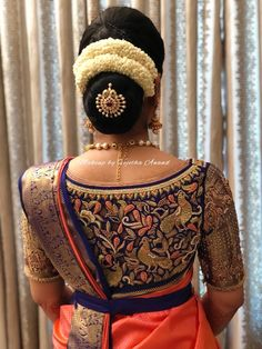 Gorgeous bridal hairstyle by Vejetha for Swank. South Indian bride. Bridal silk saree. Bridal sari blouse design. Bridal updo. Hair bun with accessory and fresh flowers.