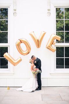 "Add gold ""LOVE"" balloon décor like this Kade Spade inspired wedding. Photography: Christine Skari Photography"