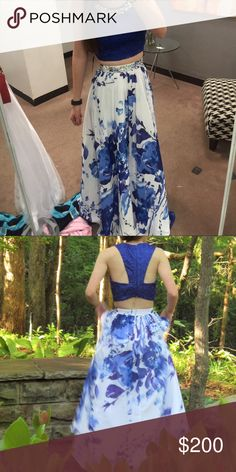 Blue floral two piece prom dress Worn twice. Bought for $220. Lowest i will take is $150. Skirt taken up to fit 5'8 Dresses Prom