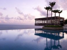 Infinite swimming pool at front facing ocean ( 40 meters away from sea?) blend with building and landscape
