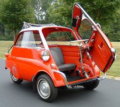 BMW Isetta bubble car--Our neighbor had a car just like this one in the 1960's. I loved riding in this little car. It was a real car on the streets, but still felt like a play car! So cute!