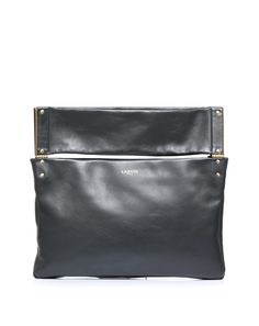 Leather thin bag with remuvable shoulderstrap. On the top of the bag two sections (front side and back side) are divided from the bag and hoocked with hardwere becoming two high handles or, when the shoulderstrap is in, to fold on themselves. A closing zip is on the top under the handles. #runin2 #luxurybag #bag #lanvin