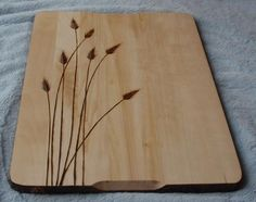 Pyrography on a Cutting Board. Very nicely done particularly like the fine work on those soft ears of grass. Very simple composition, no excessive cluttering up of the available space, well done ;)