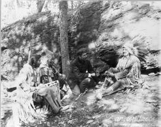 Ernest Thompson Seton with Blackfeet Indians. They were demonstrating how to make a fire with bow and stick.