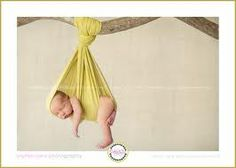 newborn photography - Have mom hold fabric and wrap around her hand...PS the branch