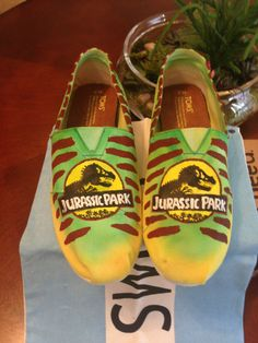 Jurassic Park Hand Painted Toms Shoes. I need to add these to my Jurassic Park shoe collection.  #jurassicpark #dinos