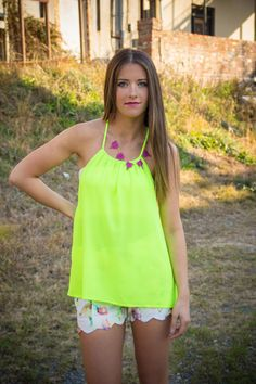 Chartreuse is your secret color for spring!  Will pair back beautifully with everything floral and is easy breezy to wear all by itself.  Rope back detail and halter neckline in a gorgeous color.  What's not to love!!  Model is wearing a size small.