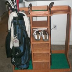 Golf Bag Organizer built by RYOBI NATION member Broski0433! Great way to keep your equipment organized and off the floor and I love the shoe rack in the middle. Perfect garage DIY project.