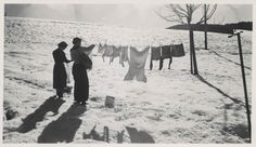 "back-then: "" Women hanging laundry in the snow Feb. 1957 Source: simpleinsomnia/flickr """