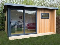 4.4x3.6m garden office with cedar cladding, cedar cheek & graphite sliding door set