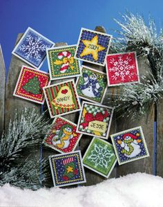 Design Works Plastic Canvas Kit LITTLE SQUARES 12 Ornaments~ Look like postage stamps... and anything plastic canvas can be translated to linen and cross stitch.
