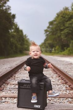 He rocked his First Birthday Photo Session in real baby rocker style. Rocker tattooed onesie, mohawk and amp props! First Birthday Photography for boys. Drummer boy ideas for 1st Birthday Photos. Spike my hawk for photo session.  Baby boy photography ideas. Posing for 1st Birthday Smash Cake.  DigitalMyst Photography specializes in children and family photography. #rocker1stbirthday #tattooedbabybirthdayideas #rockerbirthdayparty #rockerphotos #1stbirthdaysessionforboy #musicbirthdayideas