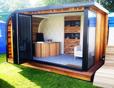 Our-Pod-Contemporary-Garden-Rooms2  fold out sliding door -> more expansive