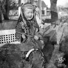 Young John playing cowboys and Indians