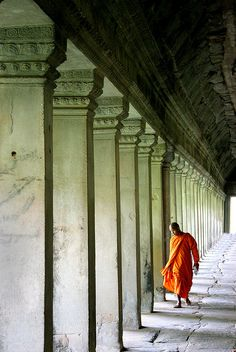 Monk Walking by Pillars at Angkor Wat by Rob Kroenert...my favorites of Cambodia