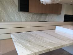 At Baasar Stone, we specialise in selling Calacatta Marble Slabs and we also have expertise in manufacturing custom made kitchen benchtop, island bench, fireplace and bath vanities of Calacatta Marble.