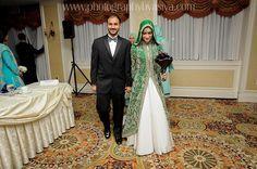 Green jacket maxi hijabi bride