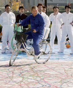 Takeshi Kitano rides a bike. And paints.