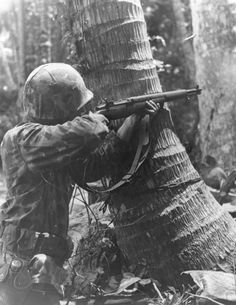U.S. marine engages the Japanese with his M1 Garand in the jungles of Bougainville, 1944.