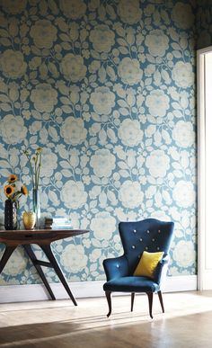 modern table, the great shape and color of that blue chair, and the swoon worthy wallpaper. I'm not sure I'm up to ever doing wallpaper, but if I do, it'll be something like that.