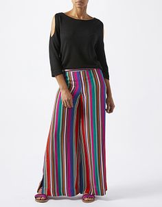 Take a rainbow palette in your stride with our Savannah wide leg trousers. Bold and bright stripes promise to turn heads, and a split side seam adds extra mo...
