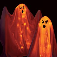 Cagey Ghosts  Out-of-use tomato cages are a restless bunch. Come Halloween, they haunt front porches as glowing ghosts.