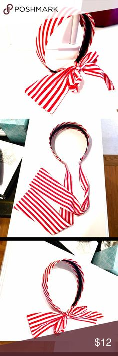 Red and White Headband with Tie Adorable red and white striped headband. Thicker on top. Had fun ribbon to tie under your hair or wrap around your pony tail in a bow. So fun for summer!! Never wore it; doesn't sit in my head right due to the width. Love it! Madewell Accessories Hair Accessories