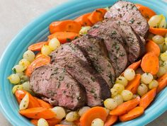 Roast Leg of Lamb With  Carrots and Pearl Onions