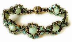 """TWEAKED JEWELED BRACELET   11/0 seed beads Miyuki """"Metallic Olive Brown"""" (11-457H)  4mm bicones """"Emerald Green"""" (no color info available)..."""