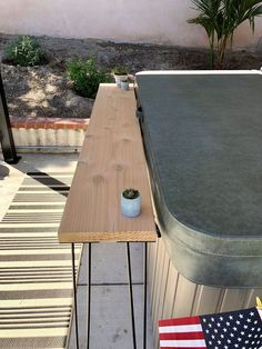 As we head into summer, make yourself an easy and affordable outdoor bar area! Whether its placed against your hot tub like ours, or just an extra space for foo…