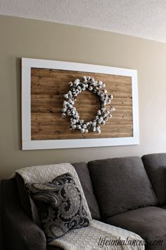A DIY wood palette decoration with a cotton wreath. A perfect piece of fall decorating that you can make yourself.