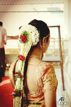 Indian Weeding :Traditional Southern Indian bride wearing bridal silk saree, jewellery and hairstyle. #IndianBridalMakeup #IndianBridalFashion kanchipuram sarees, bridal blouse, designer blouse, needle work blouse, bridal hairstyles, flower braid, Hindu wedding, temple wedding Jayanthi ballal blouse design