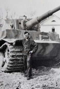 A soldier posing with a late variant Tiger 1 Tiger Ii, German Soldiers Ww2, Panzer Iii, Germany Ww2, Tiger Tank, Tank Destroyer, Ww2 Photos, Battle Tank, Ww2 Tanks