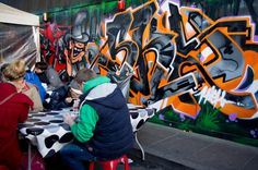 People eating street food at Brick Lane in London. Photo by alphacityguides.