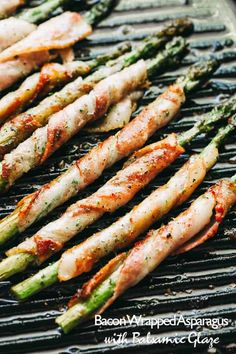 Bacon Wrapped Asparagus with Balsamic Glaze -Crispy roasted asparagus spears wrapped in bacon and brushed with a sweet balsamic and brown sugar glaze.