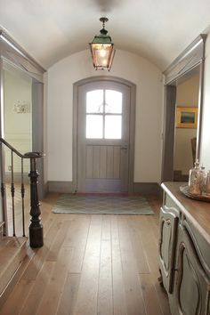 Gray area...Country style entry featuring muted gray timber door and trim with natural timber floors...reminiscent of simple Shaker style... Desiree Ashworth via House of Turquoise