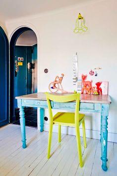 Pops of colour against white floor boards