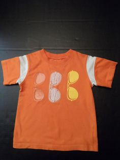 $9.97/ Orange Unisex Toddler T-Shirt by Garanimals features a sunglasses Graphic, size 3T ~Youth kids children's clothing ~~see over 20 categories of merchandise in my store. SHIPPING IS ALWAYS FREE in the USA; I do ship globally. www.shellyssweetfinds.com